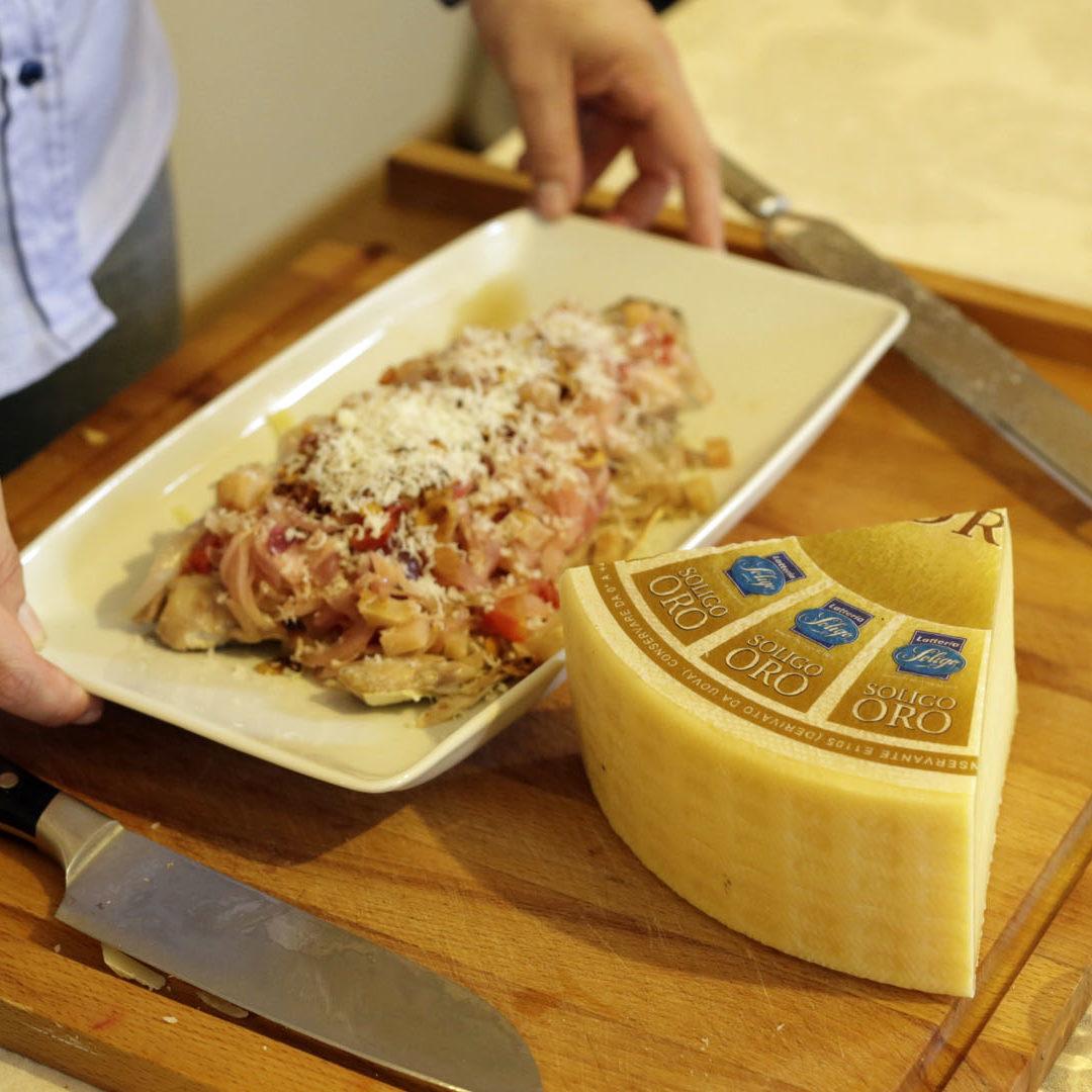 Filetto-di-ricciola-con-tropea-mandorle-e-soligo-oro-1920x1080